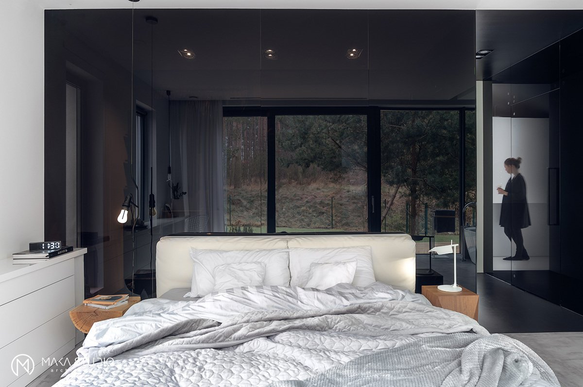Bedroom, Table Lighting, Wardrobe, Bed, Wall Lighting, and Concrete Floor  Minimal Seaside Villa