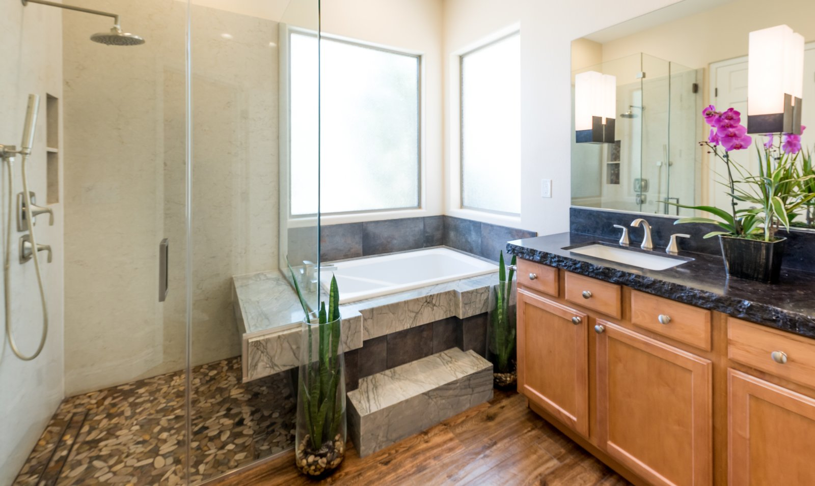 Bath Room, Quartzite Counter, Granite Counter, Engineered Quartz Counter, Undermount Sink, Porcelain Tile Floor, Drop In Tub, Enclosed Shower, Recessed Lighting, Ceiling Lighting, Stone Slab Wall, One Piece Toilet, and Pendant Lighting  Spa Escape