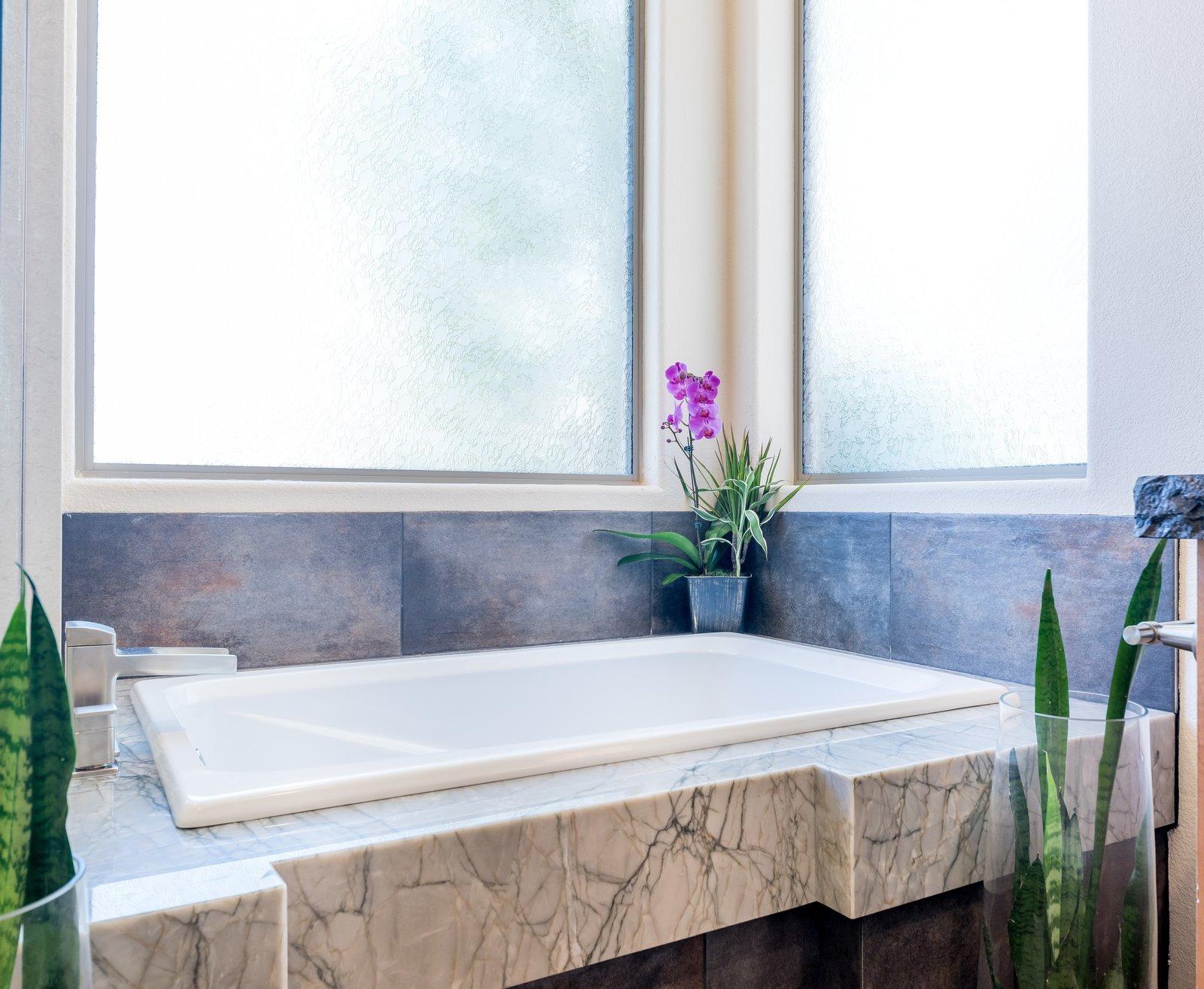 Bath Room, Engineered Quartz Counter, and Porcelain Tile Floor  Spa Escape