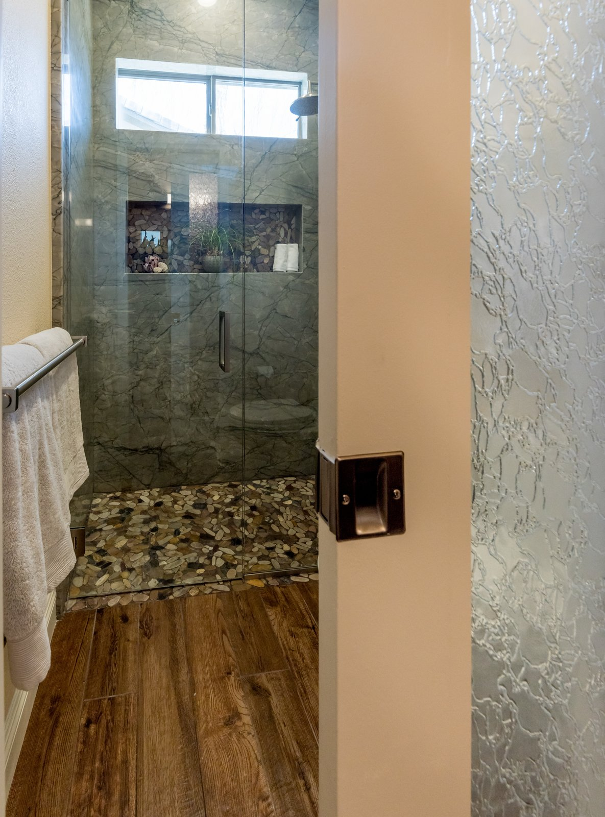 Bath Room, Quartzite Counter, Full Shower, Undermount Sink, Porcelain Tile Floor, Ceiling Lighting, Pendant Lighting, Recessed Lighting, Stone Slab Wall, and One Piece Toilet  Spa Escape