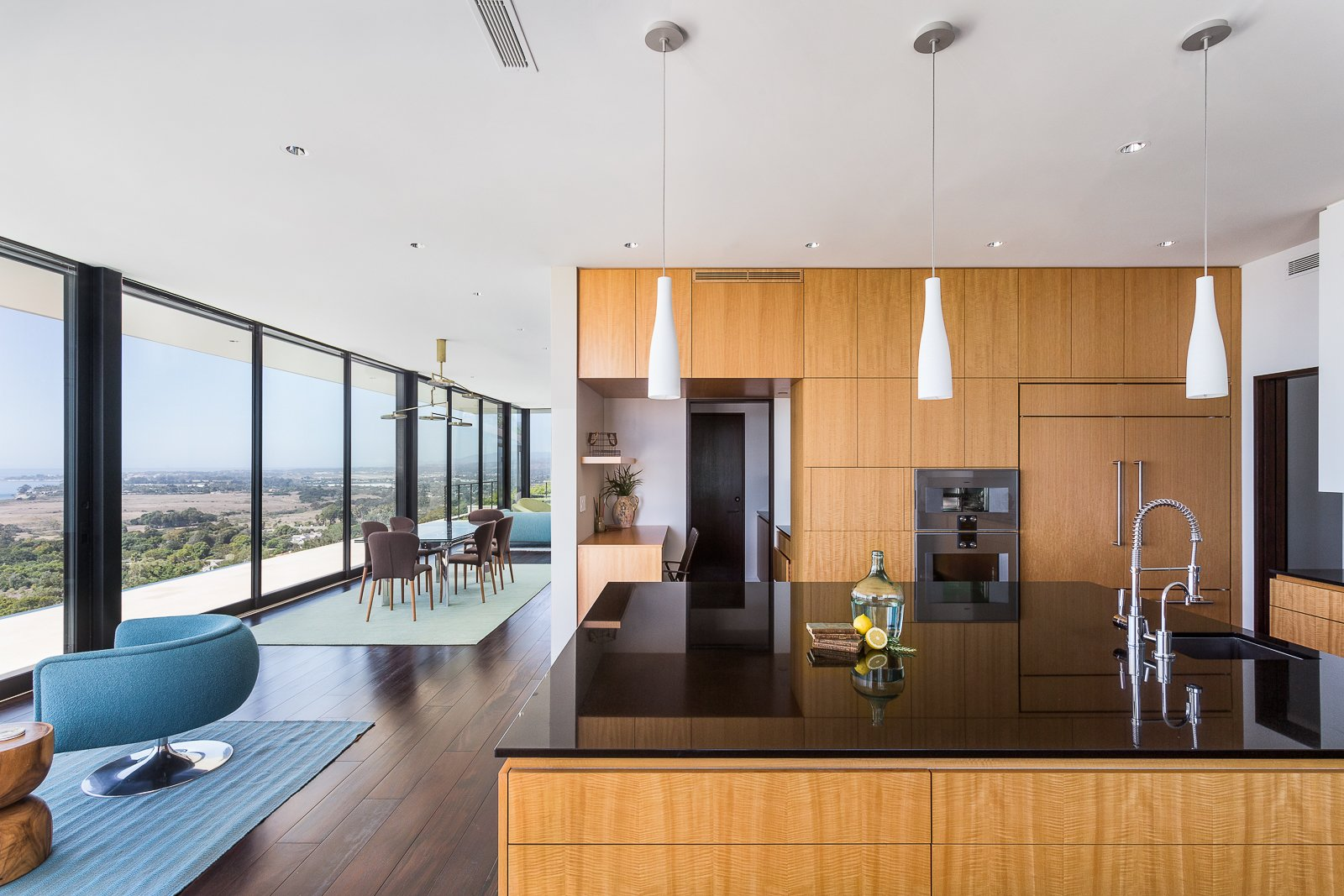 Kitchen, Wall Oven, Dark Hardwood Floor, Recessed Lighting, Pendant Lighting, and Drop In Sink  Hope Ranch Residence by Blackbird Architects