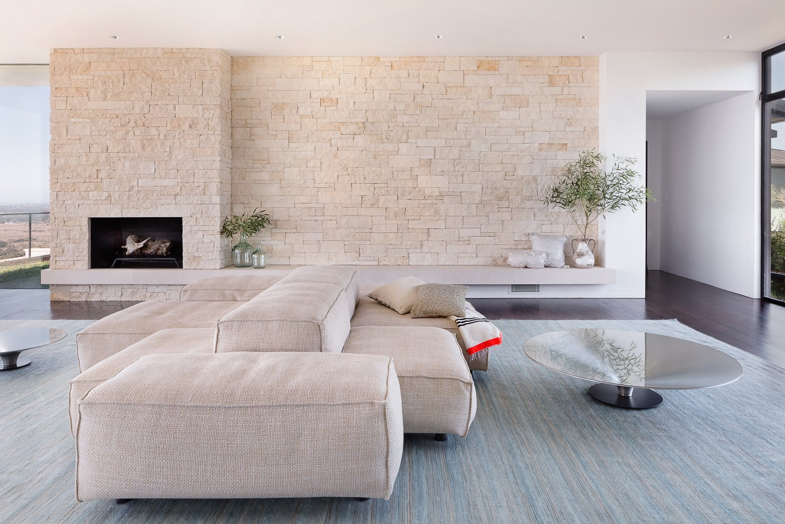 Living Room, Sectional, Coffee Tables, Recessed Lighting, Dark Hardwood Floor, and Gas Burning Fireplace  Hope Ranch Residence by Blackbird Architects