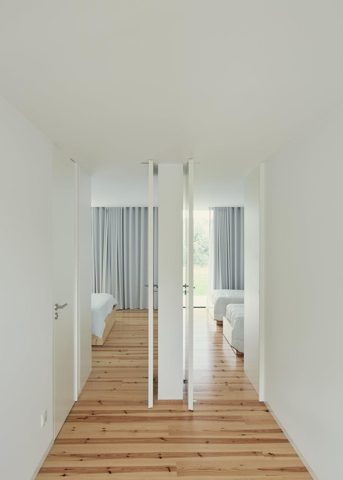 Bedroom, Bed, and Medium Hardwood Floor  Fanu House