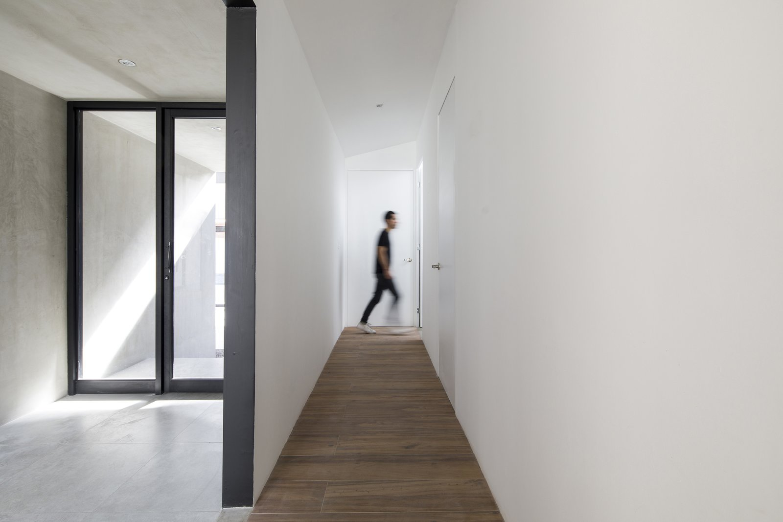 Hallway and Porcelain Tile Floor  Photo 4 of 5 in Top 4 Homes of the Week That Celebrate Earth Tones from Casa Ching
