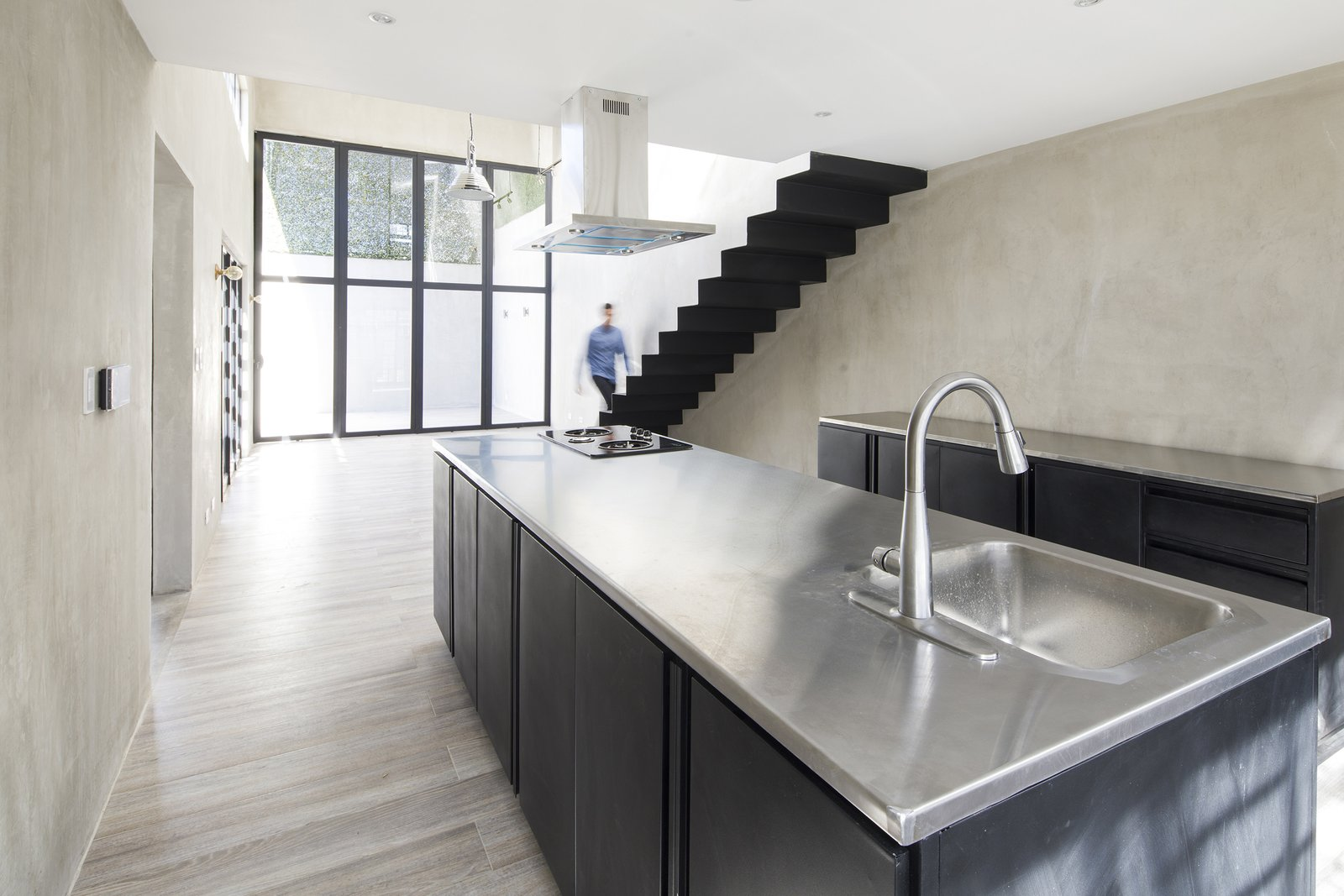 Kitchen, Metal Counter, Metal Cabinet, Porcelain Tile Floor, and Ceiling Lighting  Casa Ching by MG design studio