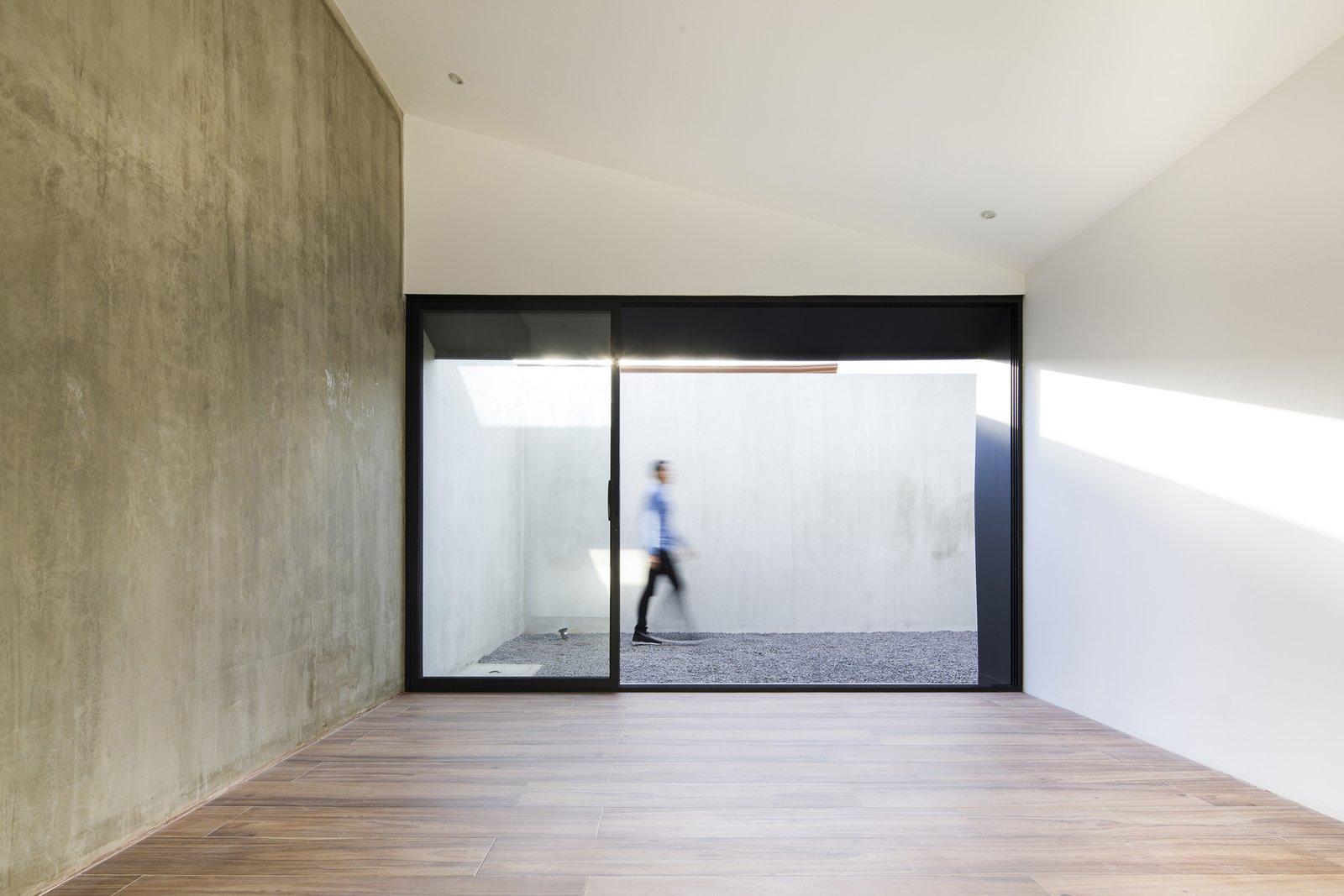 Bedroom, Ceiling Lighting, and Porcelain Tile Floor  Casa Ching by MG design studio