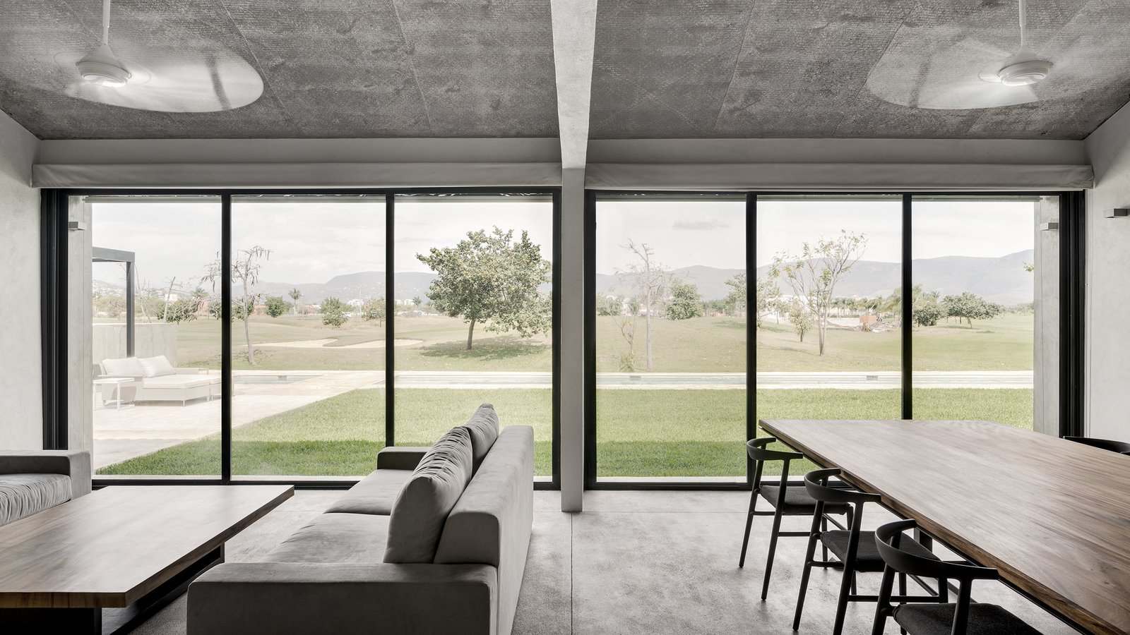 Chair, Sofa, Dining Room, Concrete Floor, and Table  Casa Paraíso by DCPP by LCMX