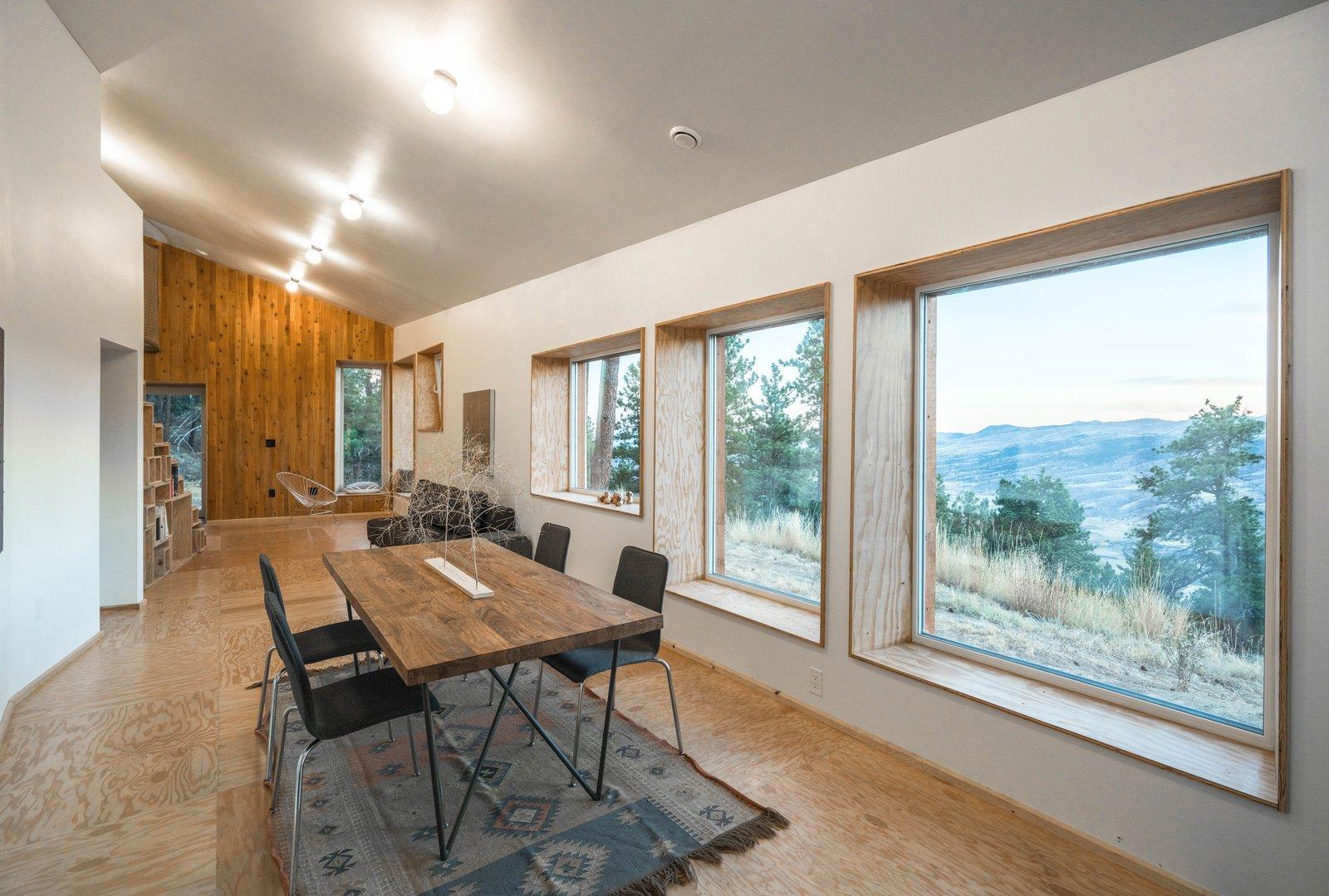Living Room, Light Hardwood Floor, Table, Chair, and Ceiling Lighting  MARTaK Passive House
