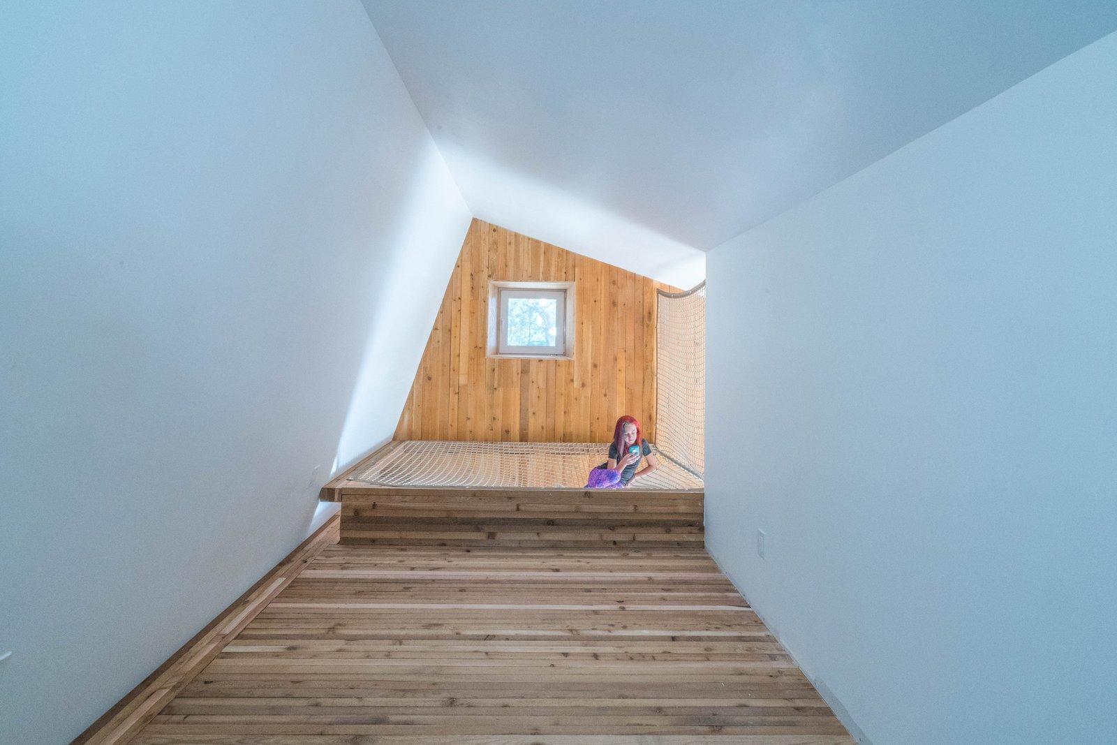 Light Hardwood Floor, Bedroom Room Type, Teen Age, Bed, Neutral Gender, and Bedroom  MARTaK Passive House