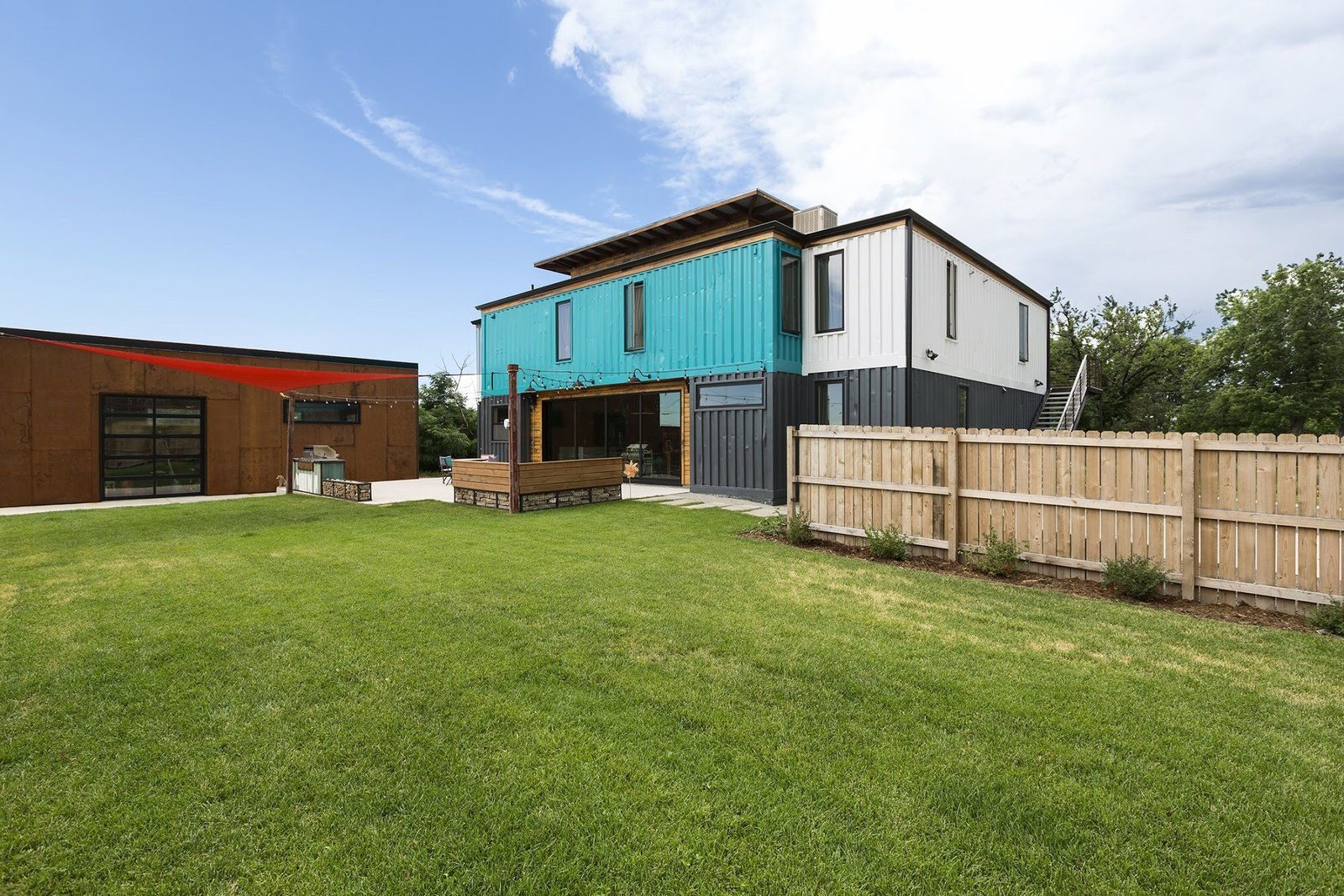 Outdoor, Back Yard, Wood Patio, Porch, Deck, Metal Patio, Porch, Deck, Concrete Patio, Porch, Deck, and Large Patio, Porch, Deck  The Container house