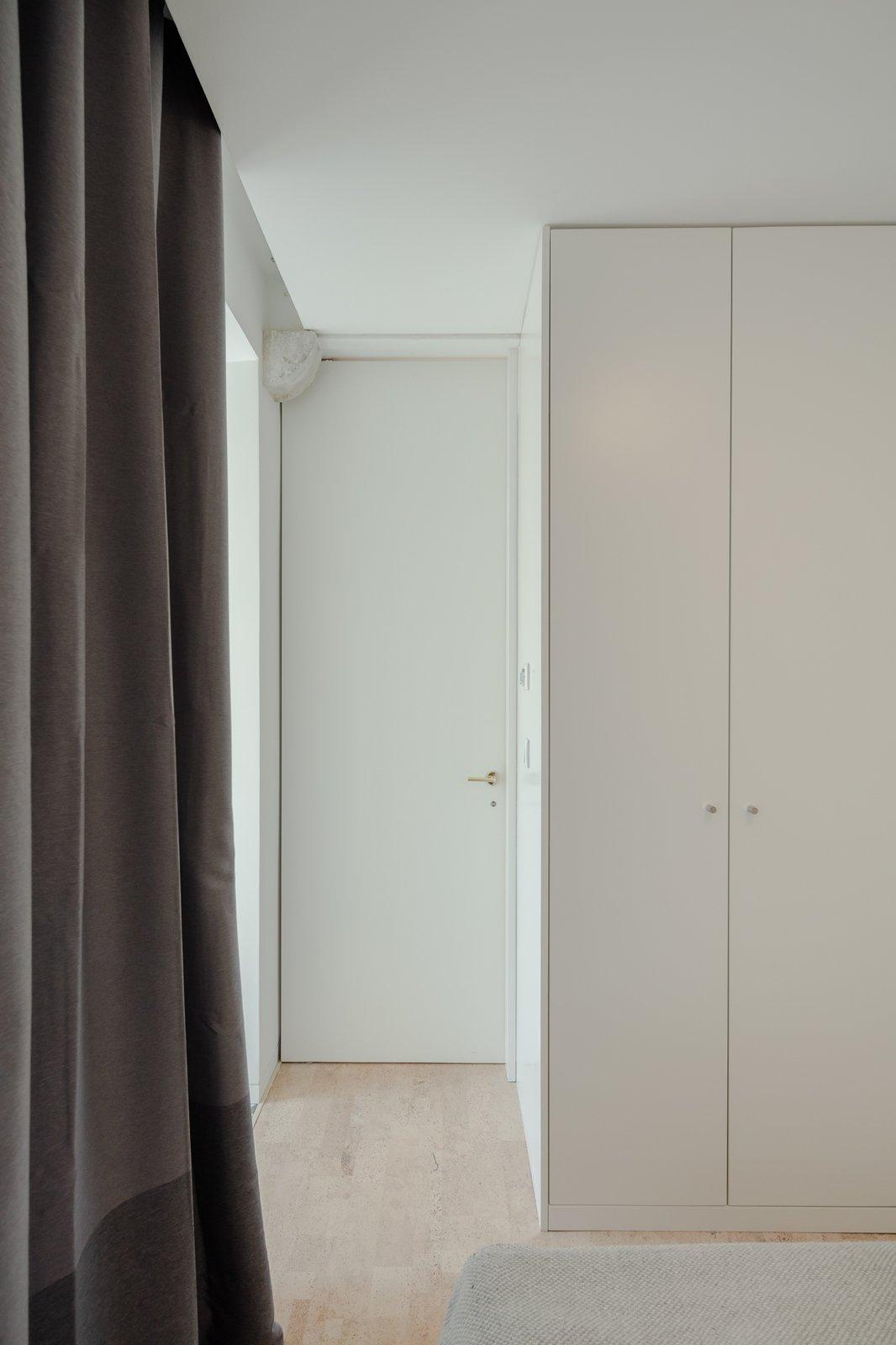 Bedroom, Wardrobe, and Cork Floor  Rua Maria Loft
