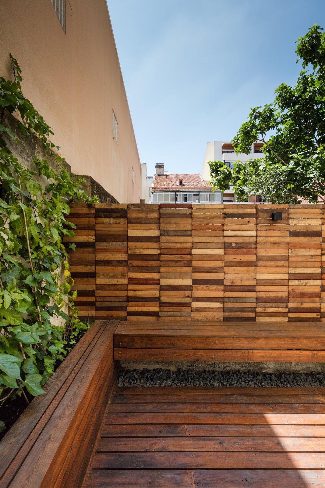 Outdoor, Back Yard, Wood Patio, Porch, Deck, Small Patio, Porch, Deck, Horizontal Fences, Wall, and Wood Fences, Wall  Rua Maria Loft
