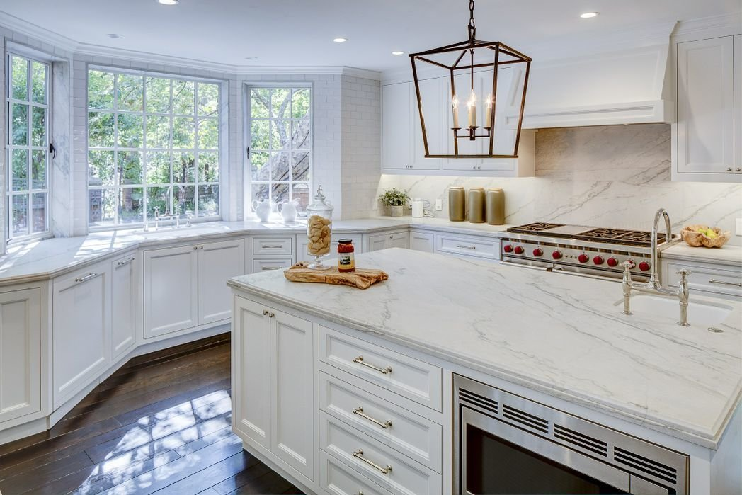 Kitchen, Marble Counter, White Cabinet, Dark Hardwood Floor, Ceiling Lighting, and Wall Oven  Gerard Colcord-Designed Bel Air Estate