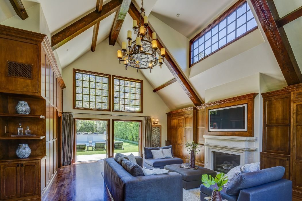 Living Room, Chair, Ceiling Lighting, Sofa, and Standard Layout Fireplace  Gerard Colcord-Designed Bel Air Estate