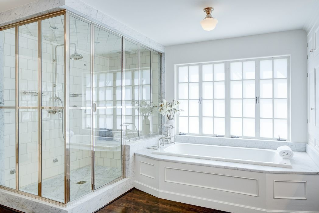 Bath Room, Marble Counter, Dark Hardwood Floor, Ceiling Lighting, Enclosed Shower, and Drop In Tub  Gerard Colcord-Designed Bel Air Estate