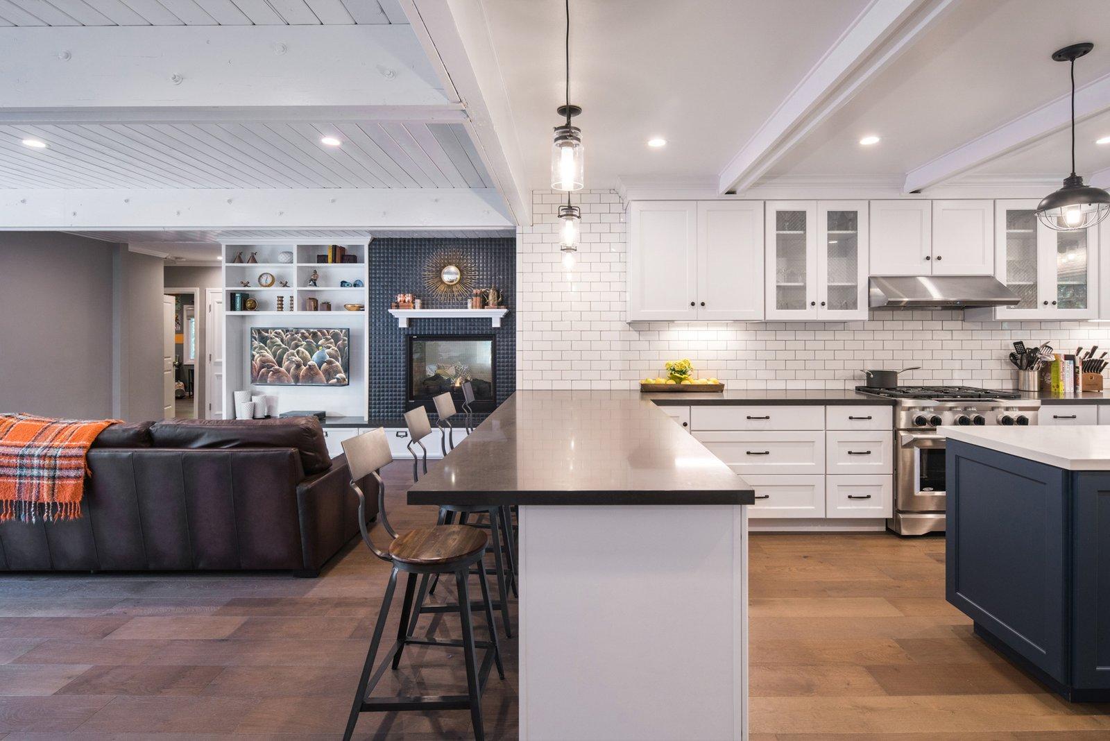 Subway Tile, Ceiling, White, Pendant, Sofa, Kitchen, Standard Layout, Medium Hardwood, Range Hood, Engineered Quartz, and Range  Best Kitchen Standard Layout Range Photos from The Pasadena Farmhouse