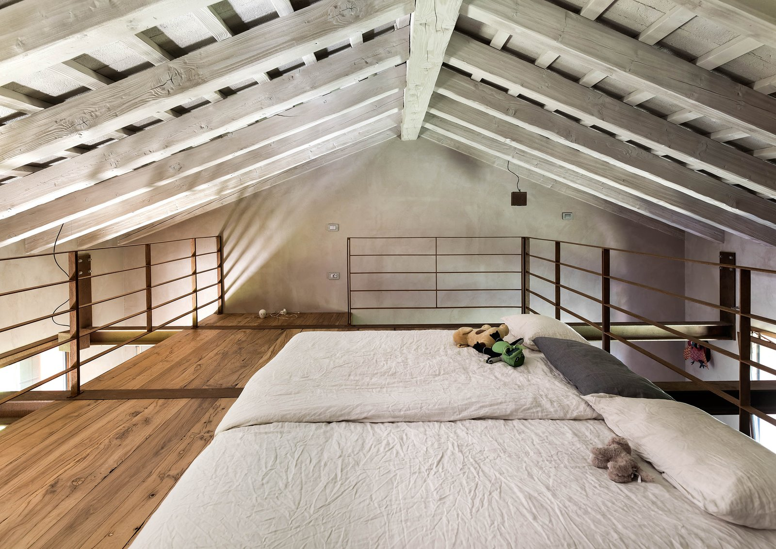 Bedroom, Bed, Ceiling Lighting, and Medium Hardwood Floor  Country House by zanon architetti associati