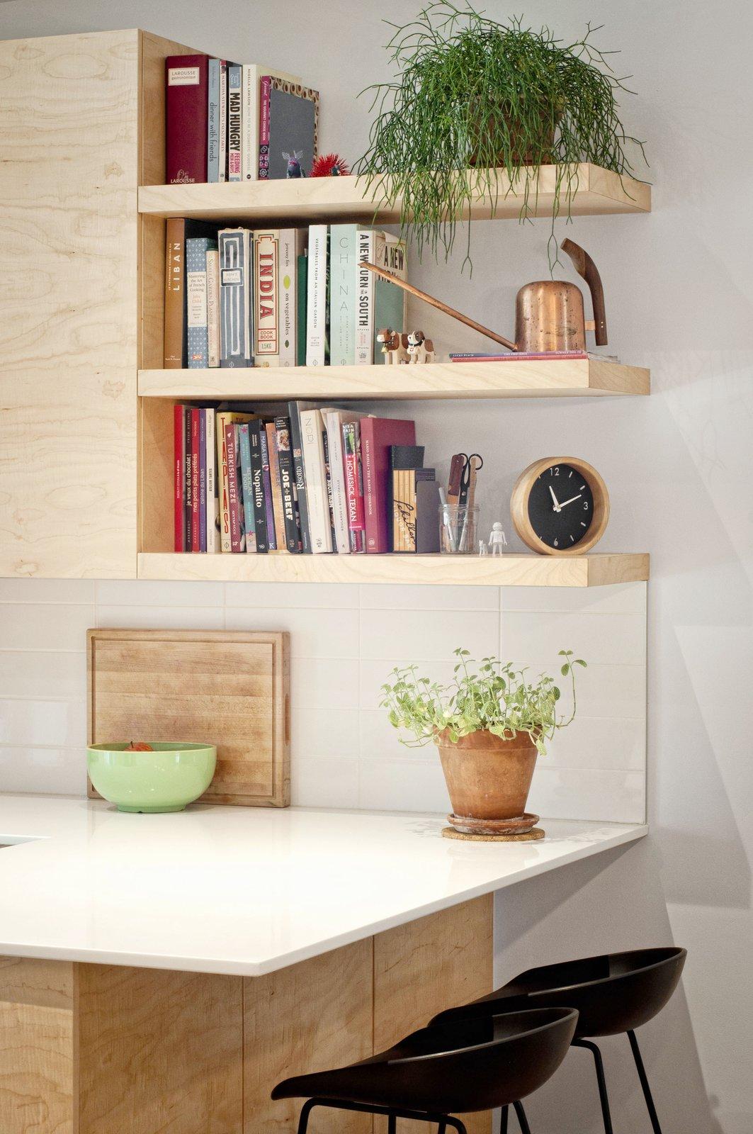 Kitchen, Engineered Quartz Counter, Wood Cabinet, and Ceramic Tile Backsplashe  Fabre Residence