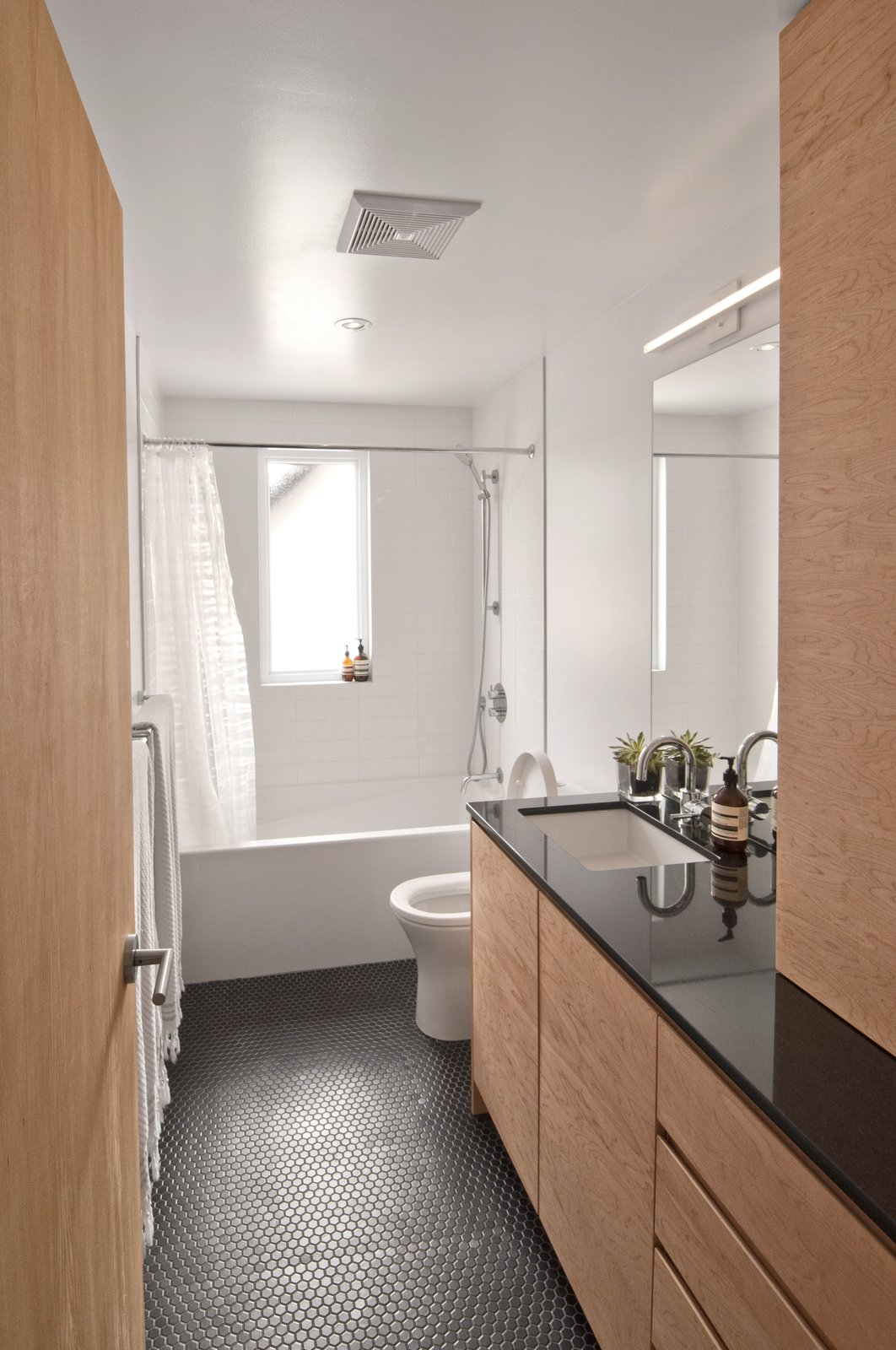 Bath Room, Undermount Sink, Porcelain Tile Floor, Granite Counter, Alcove Tub, Open Shower, Recessed Lighting, Ceramic Tile Wall, and Two Piece Toilet  Fabre Residence
