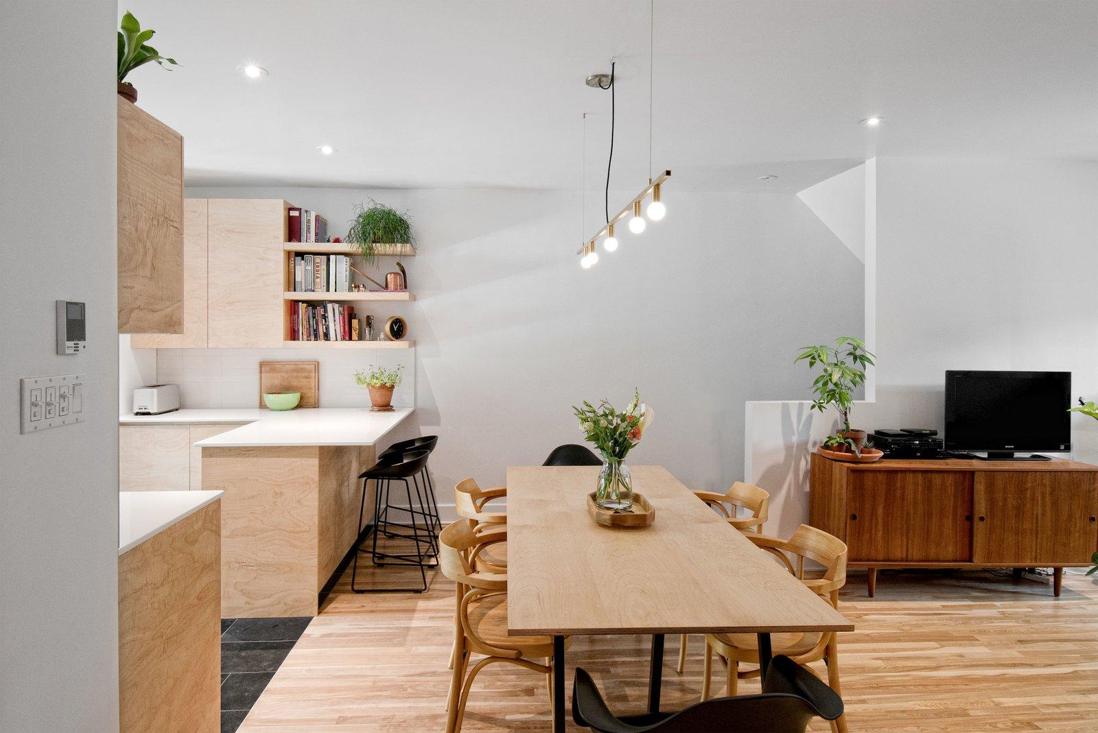 Wood Cabinet, Engineered Quartz Counter, Light Hardwood Floor, Subway Tile Backsplashe, Slate Floor, Pendant Lighting, Undermount Sink, Ceiling Lighting, Stools, Table, Chair, Kitchen, and Lamps  Fabre Residence