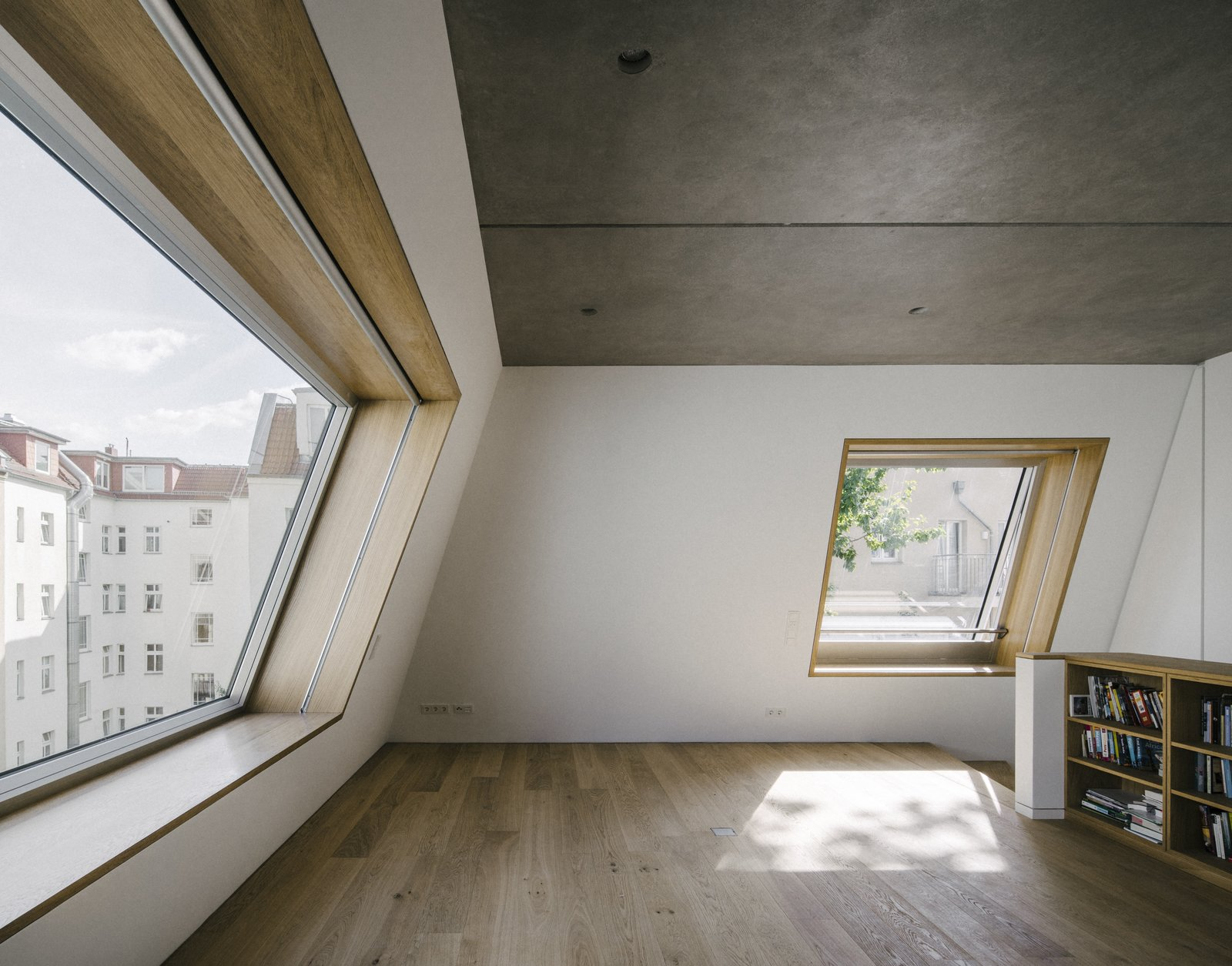 Bookcase, Wood, Picture Window Type, Skylight Window Type, Hallway, and Concrete Floor  Apartment House Prenzlauer Berg by Barkow Leibinger