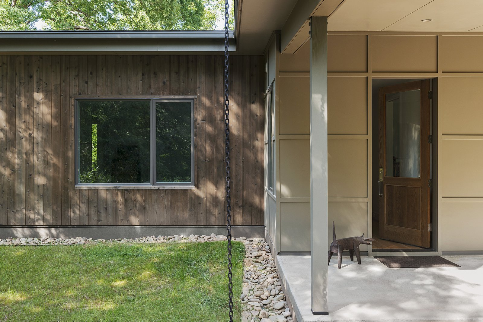 Grass, Concrete Patio, Porch, Deck, Doors, Exterior, and Wood  The Hammock House by Samsel Architects