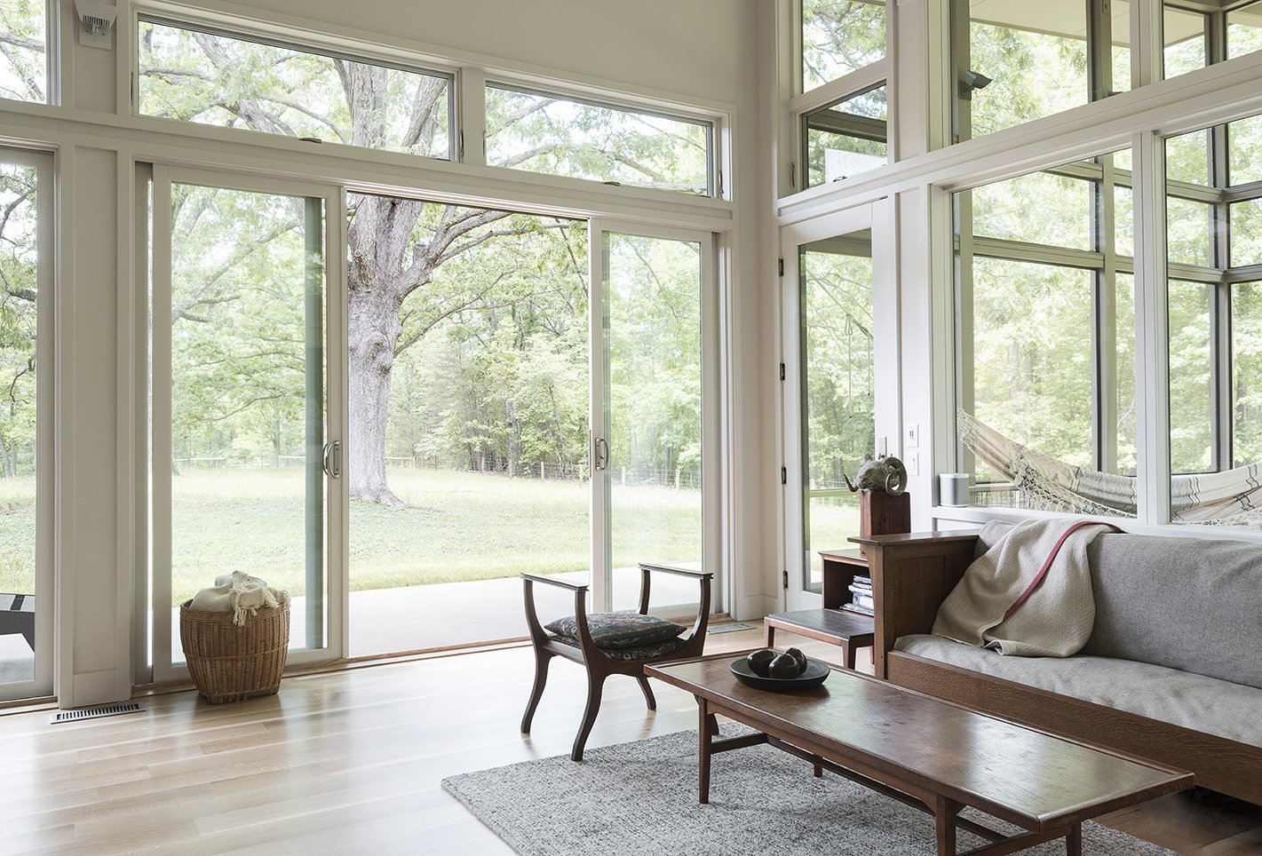 Living Room, Sofa, Chair, Coffee Tables, and Light Hardwood Floor  The Hammock House by Samsel Architects