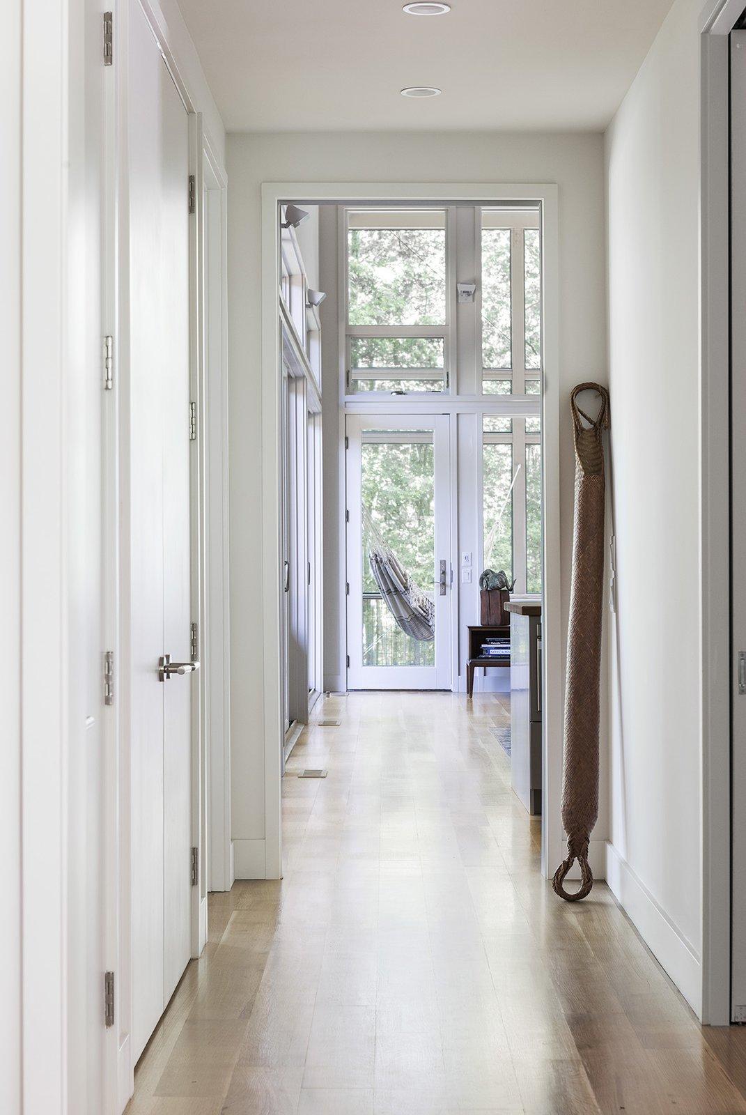 Hallway and Light Hardwood Floor  The Hammock House by Samsel Architects