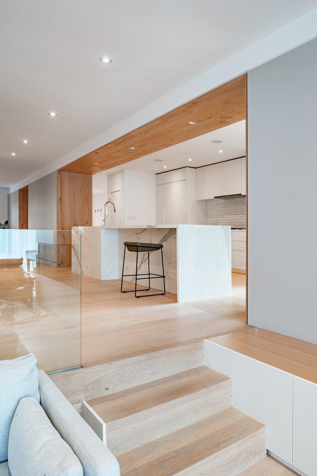 Kitchen, Quartzite Counter, White Cabinet, Light Hardwood Floor, Subway Tile Backsplashe, Refrigerator, Recessed Lighting, and Ceiling Lighting  Richview Residence