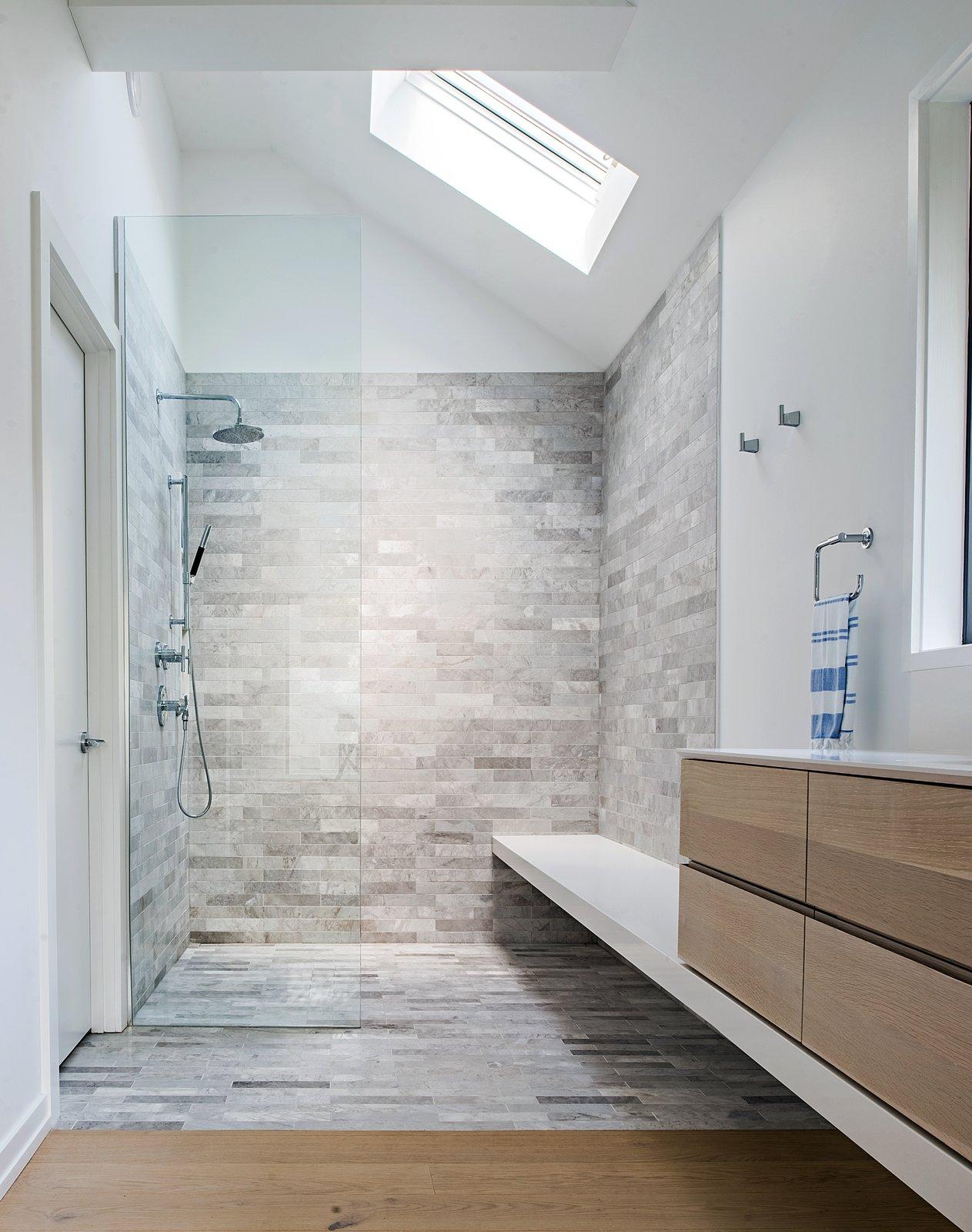 Bath Room, Engineered Quartz Counter, Light Hardwood Floor, Freestanding Tub, Undermount Sink, Open Shower, Ceiling Lighting, and Stone Tile Wall  Richview Residence