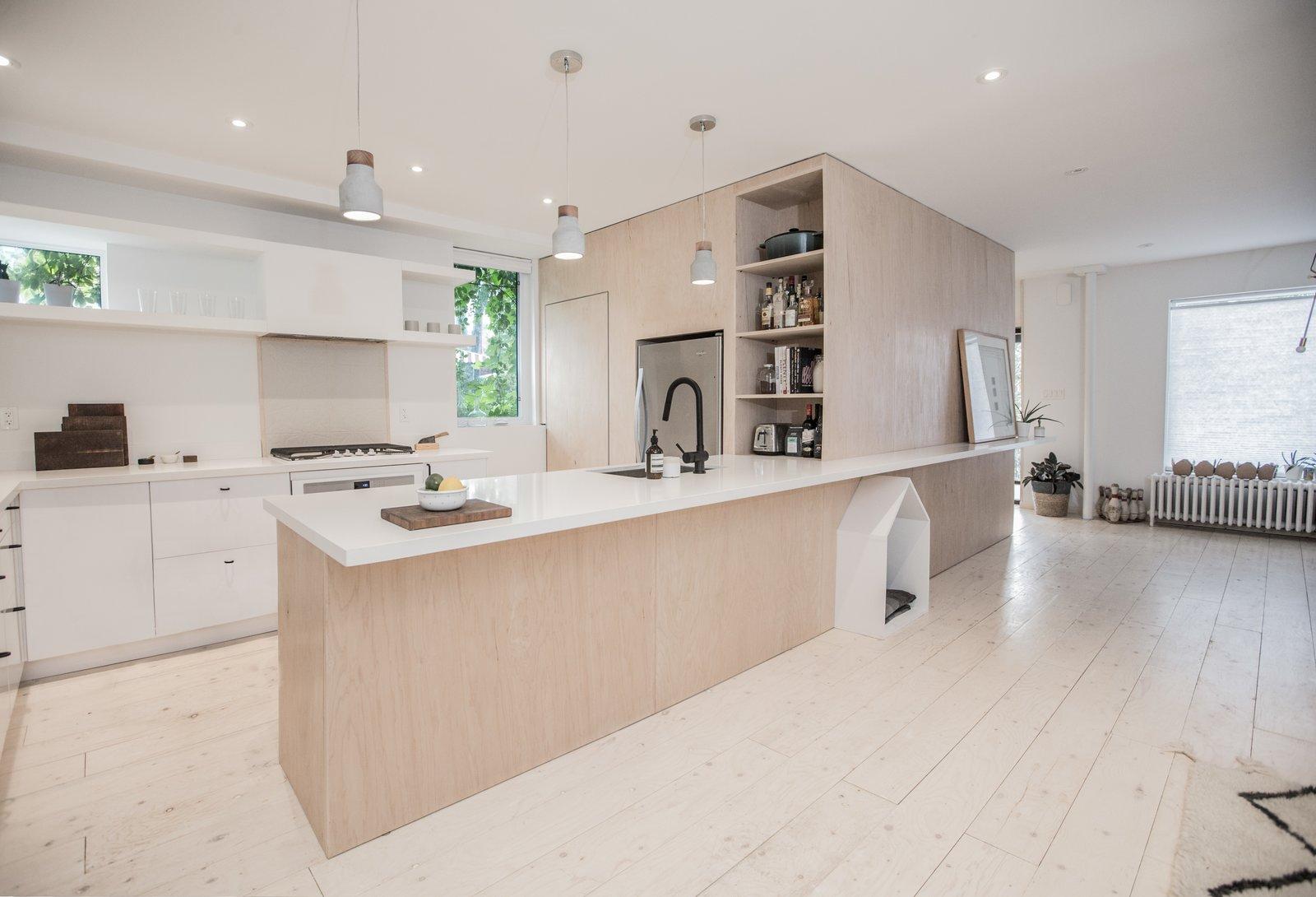 Kitchen, Light Hardwood Floor, and Pendant Lighting  Sheridan Residence