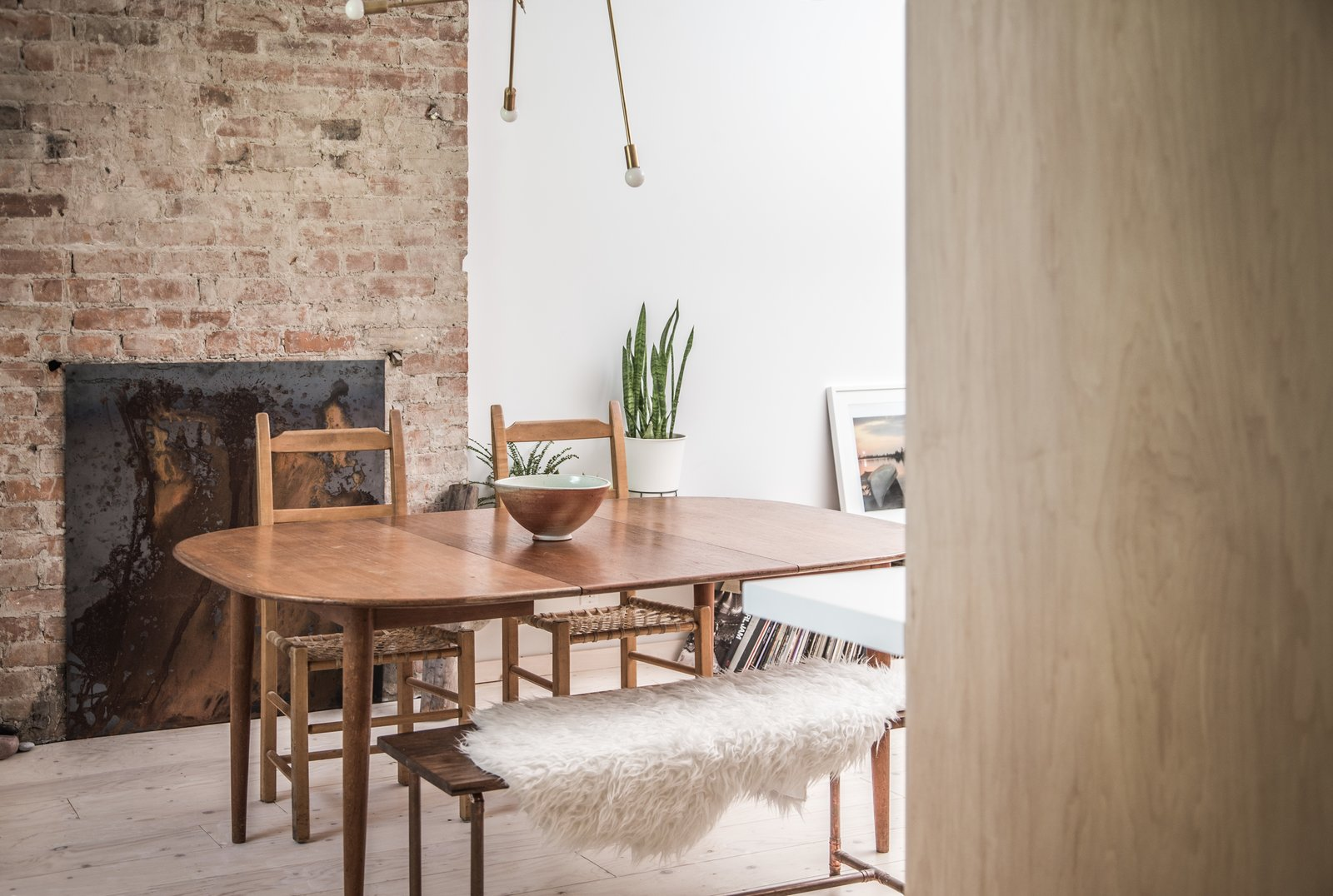 Dining Room, Bench, Chair, Table, Light Hardwood Floor, and Pendant Lighting  Sheridan Residence