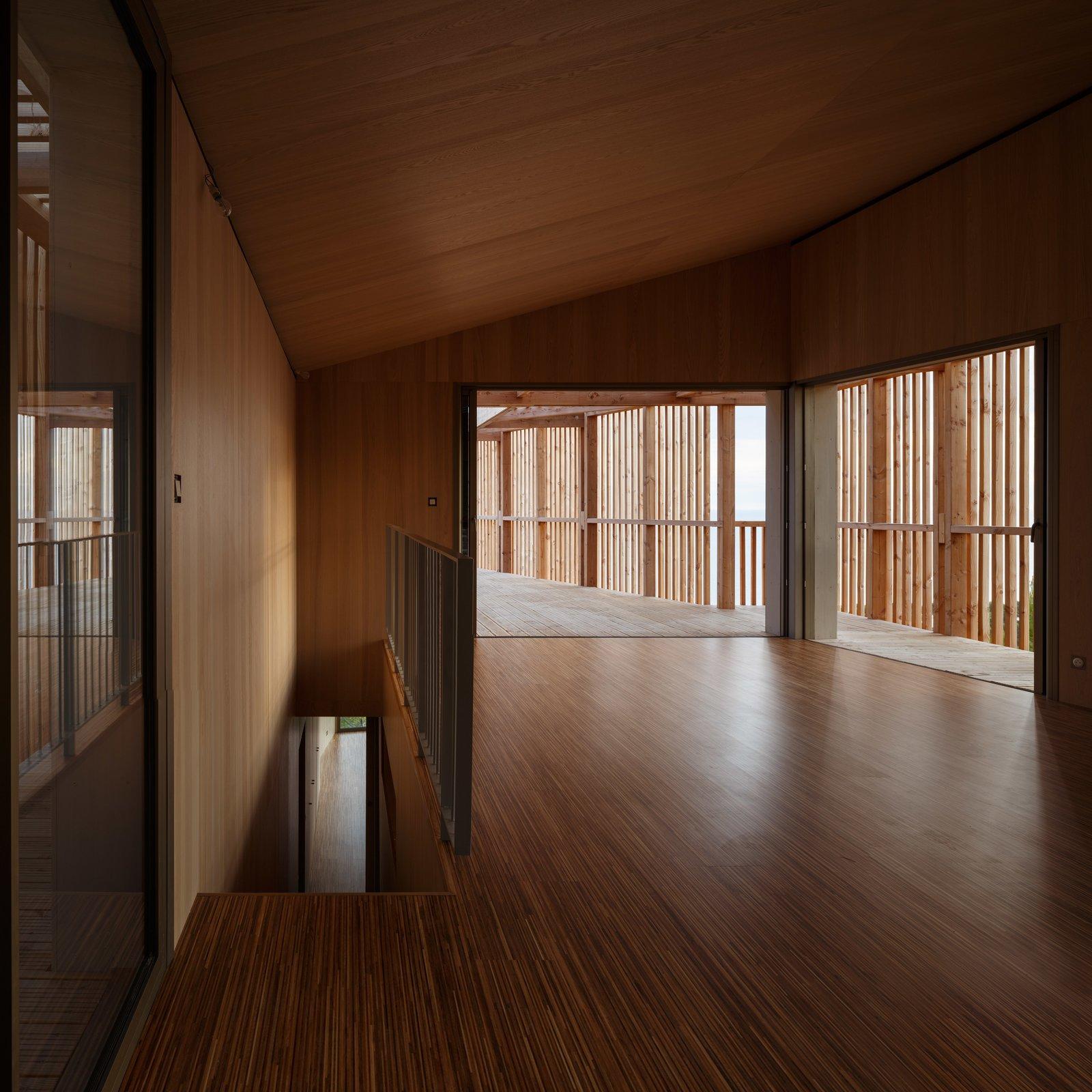 Living Room, Medium Hardwood Floor, and Wall Lighting  The KGET in Marseille