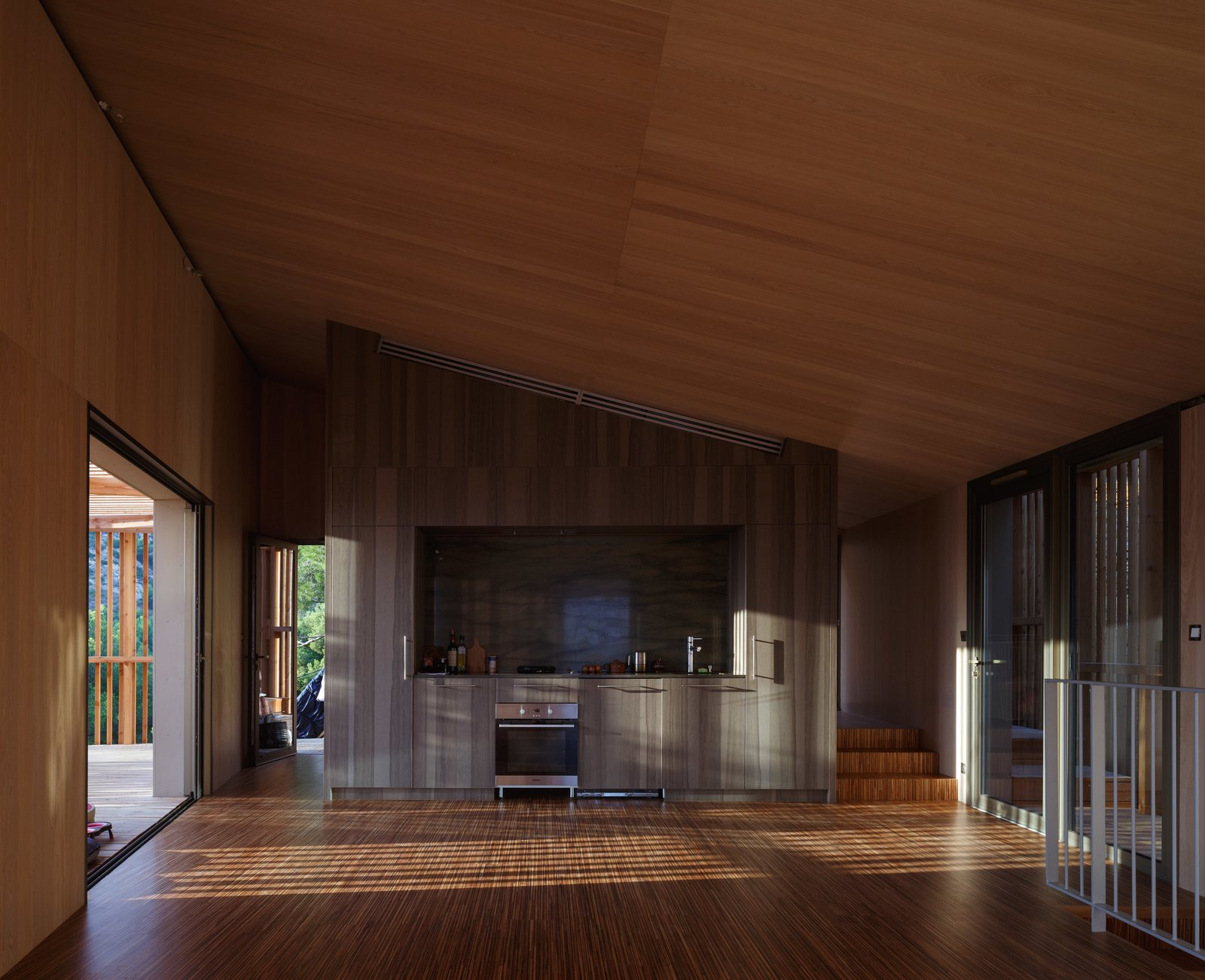 Medium Hardwood Floor, Kitchen, Granite Counter, Wall Lighting, and Wood Cabinet  The KGET in Marseille