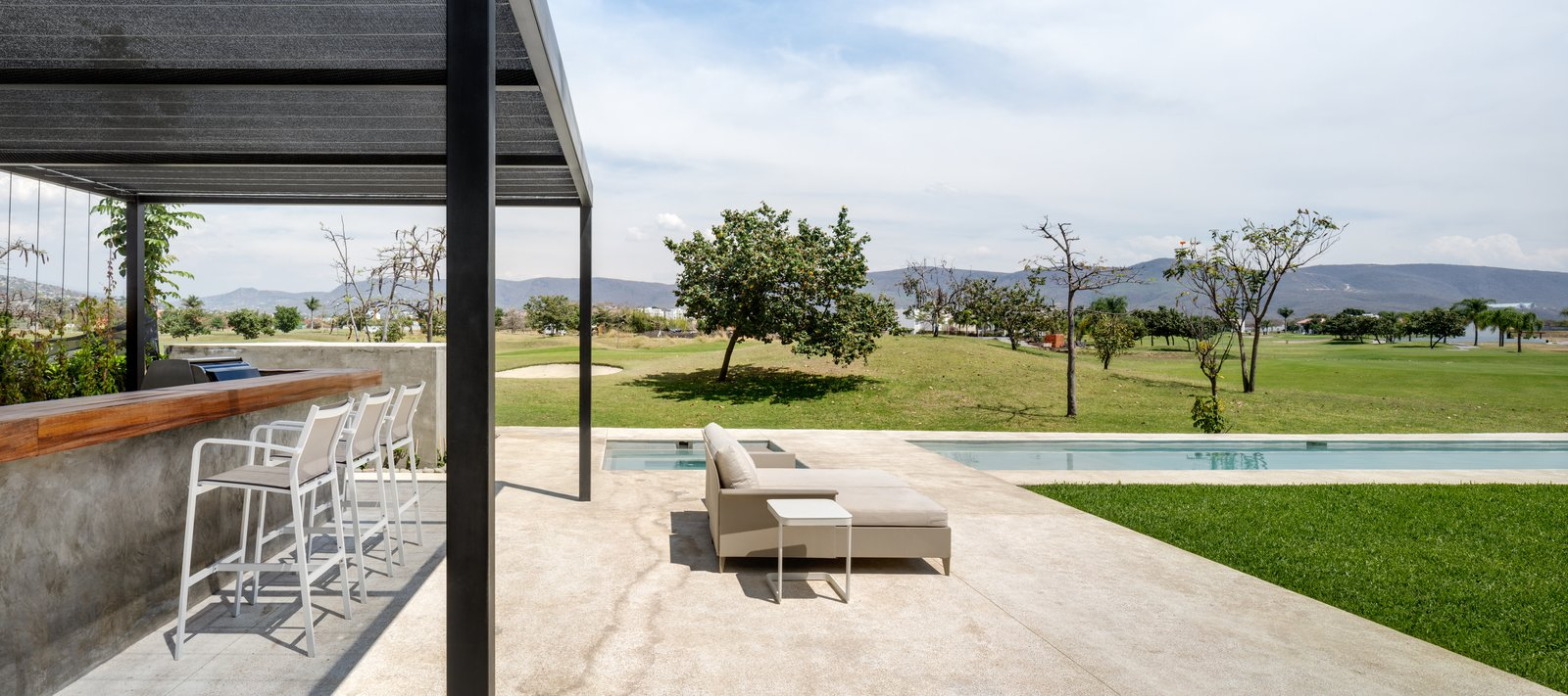 Outdoor, Trees, Infinity Pools, Tubs, Shower, Large Pools, Tubs, Shower, and Back Yard  Casa Paraíso Country Club by DCPP