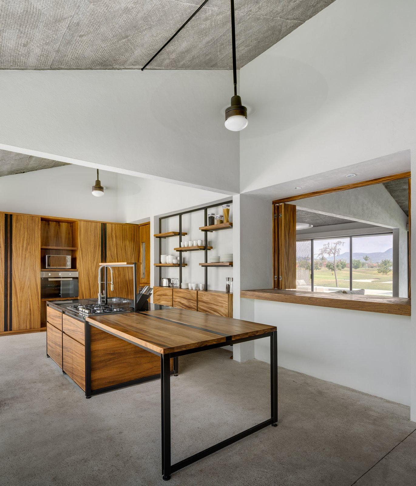 Kitchen, Granite Counter, and Wood Cabinet  Casa Paraíso Country Club by DCPP