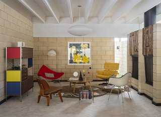 "Primary colors and bold art dominate the home's decor. ""The yellow and green Warhol flowers—that's my favorite Warhol. My last name means flowers in Italian. So I just l love flowers,"" says Florentino."
