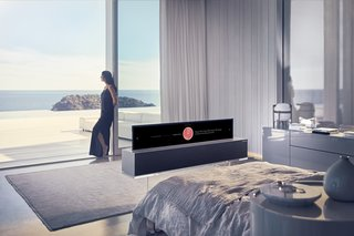 "The LG OLED TV R rolls into its base, sit in ""line mode"" (pictured) or roll up for a full TV screen"