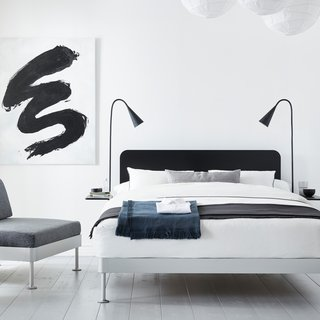 A black headboard and two matching side tables can be easily removed from the Delaktig bed frame to create a whole new look in minutes.