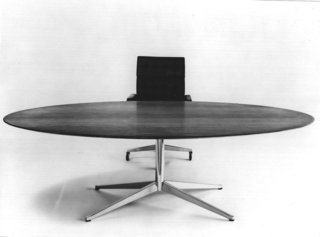 Florence Knoll's Table Desk completely upended the concept of what a desk should be. Gone were the drawers, ornate carvings and heavy, imposing presence of its corporate predecessors, replaced instead by a design that has become the gold standard of executive offices.