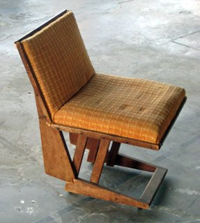 This Rudolph Schindler wooden folding chair, 1930s, is also missing.