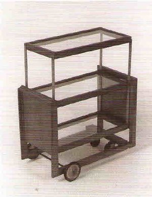 """A Rudolph Schindler tea cart from the 1930s, constructed of wood, glass, metal, and rubber, and measuring 32 1/4"""" x 28"""" x 17 1/2"""", is among the items taken from the Freeman collection."""