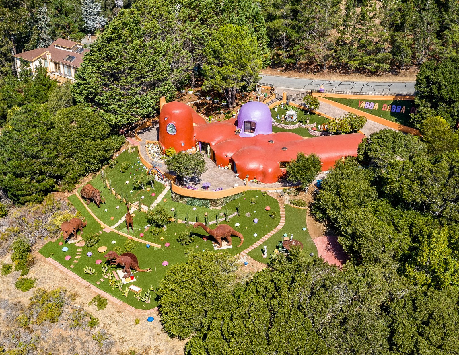 Exterior, Stone Siding Material, Curved RoofLine, and House Building Type  Best Photos from Northern California's Infamous Flintstone House Is Being Sued as a 'Public Nuisance'
