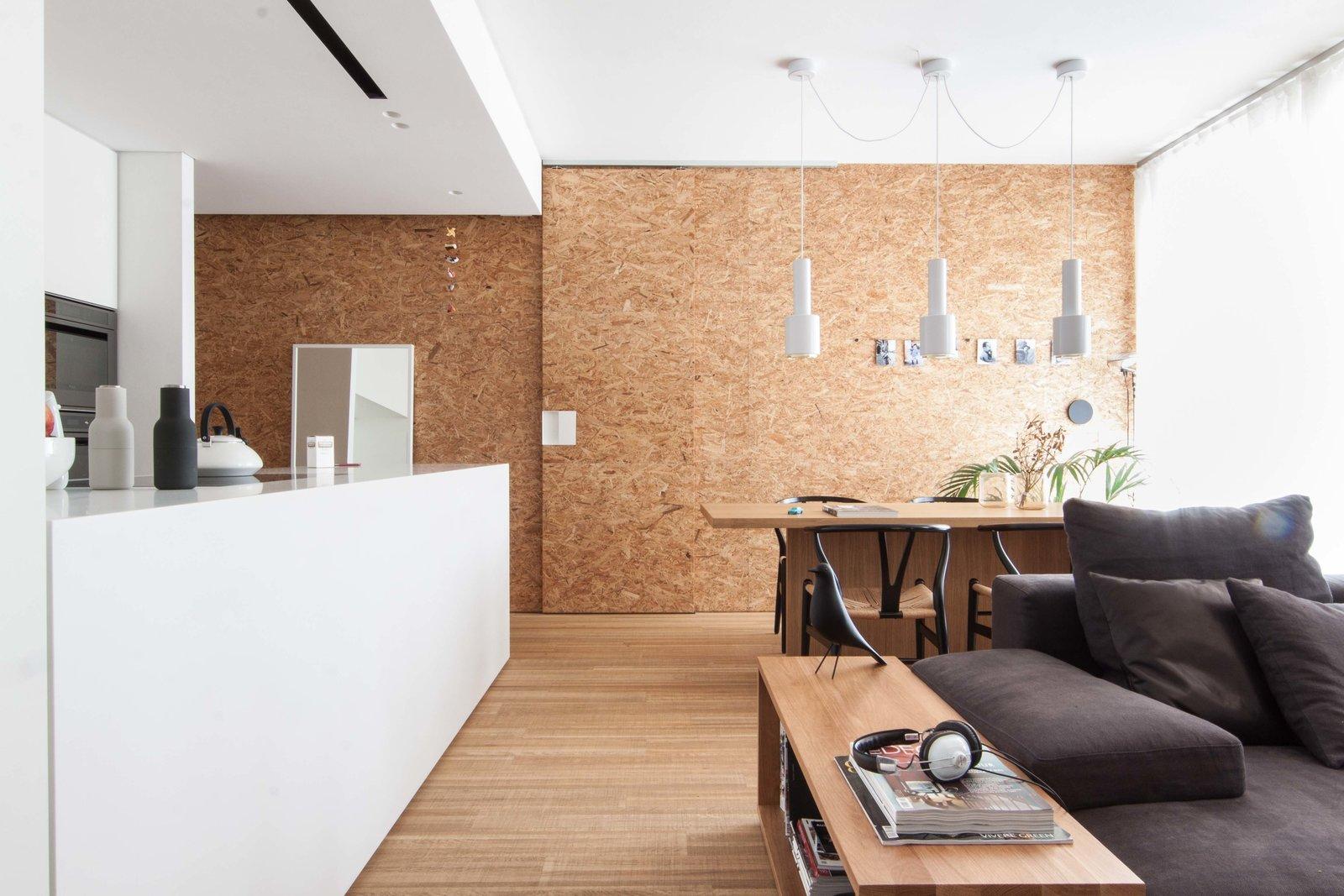 Living Room, Ceiling Lighting, Pendant Lighting, Bench, Sofa, and Medium Hardwood Floor  Interior LP by Didonè Comacchio