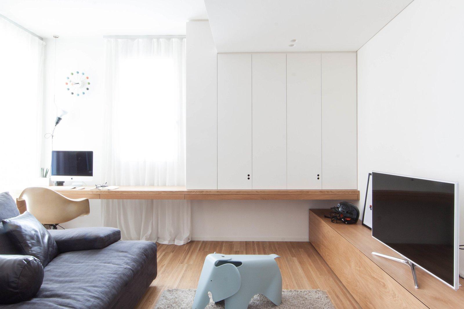 Living Room, Chair, Sofa, Desk, Lamps, Ceiling Lighting, Floor Lighting, Pendant Lighting, and Medium Hardwood Floor  Interior LP by Didonè Comacchio