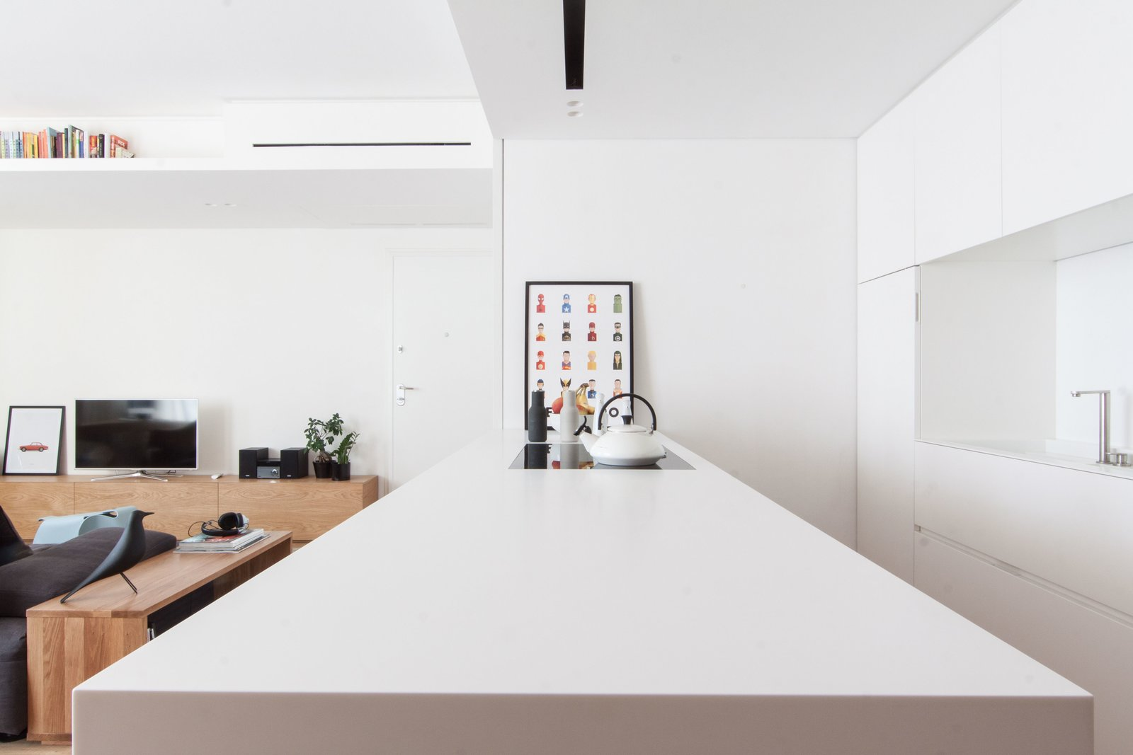 Kitchen, Medium Hardwood Floor, Ceiling Lighting, White Cabinet, Refrigerator, Wall Oven, Cooktops, Microwave, Dishwasher, and Undermount Sink  Interior LP by Didonè Comacchio