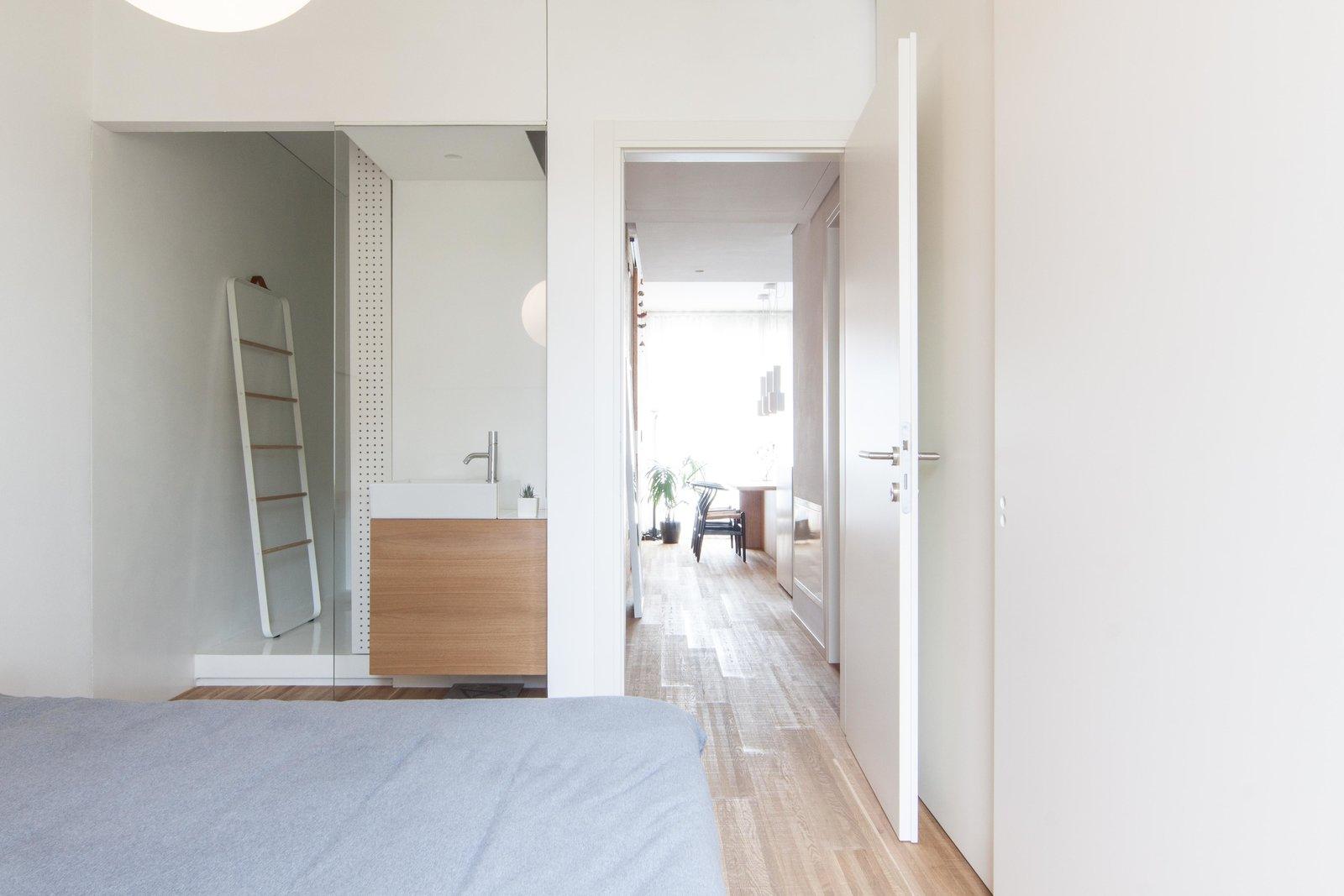 Bedroom, Bed, Pendant Lighting, Dresser, Wardrobe, Ceiling Lighting, and Medium Hardwood Floor  Interior LP by Didonè Comacchio