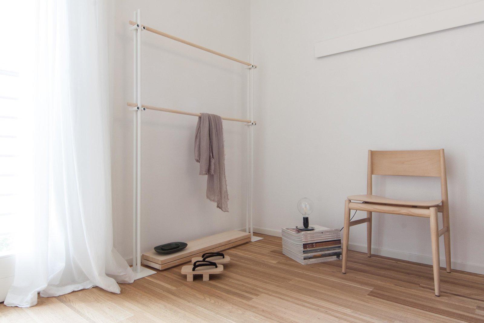 Bedroom, Dresser, Chair, Shelves, Lamps, Floor Lighting, Wall Lighting, and Medium Hardwood Floor  Interior LP by Didonè Comacchio