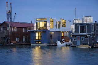 Paying homage to San Francisco's industrial history, this floating home by Robert Nebolon incorporates metal siding, a sawtooth roof, and warehouse-style window casements on the exterior. Inside, the three-level, 2,100-square-foot home has an open and flowing floor plan on the top floor, where the living areas are located. The middle and lower floors hold the bedrooms, bathrooms, and storage areas.