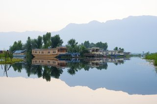 "Originally, houseboats in India's Kashmir region were used as hotels by British colonists during the 19th century, and today, there are more than 1,000 in the area. Sukoon, a houseboat from the 1970s, was recently transformed into an ""eco-luxury"" resort with five suites, a sundeck, and an elegant furnished interior."